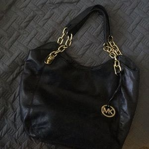 Micheal kors medium purse. Black and gold accents